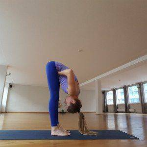 uttanasana-with-fist-massage-300x300.jpg